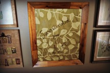 "I like to put fabric behind picture frames, then use the glass as a ""white"" board."
